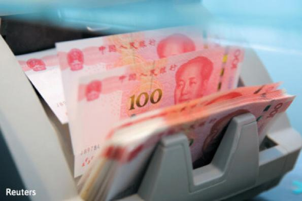 China fixes yuan mid-point at 6.8957/dollar, weakest since mid-Jan