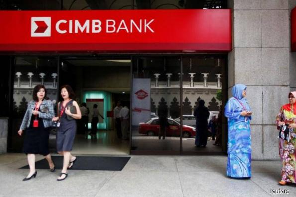 CIMB dips 1% on downgrade, lower target price
