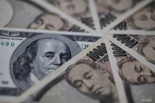 Dollar edges higher, bolstered by rising U.S. yields