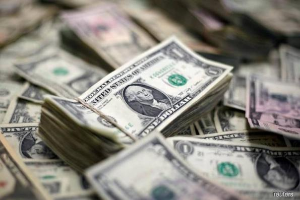 Dollar approaches 7-month high, trade tensions limit gains
