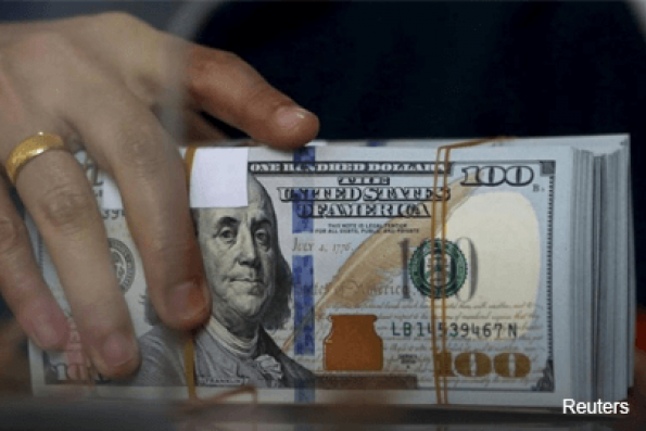 Dollar gains on March rate hike hopes ahead of Trump speech