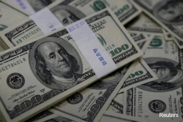 Dollar edges up as market awaits Trump's tax plan