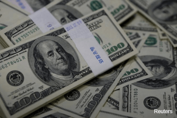 Dollar falls after Fed, Aussie soars on record trade surplus
