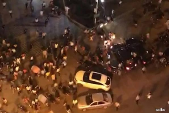 Nine dead as car ploughs into square in southern China