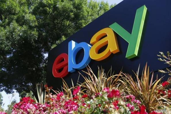 EBay website tweaks drive strong holiday sales, shares jump