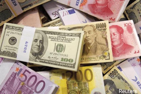 Dollar rises for 3rd day on upbeat U.S. data, higher risk appetite
