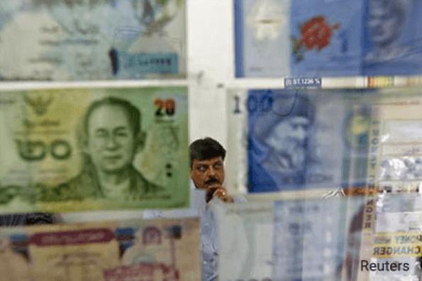 Asian currencies slip on caution ahead of Trump-Xi meeting