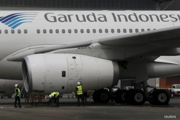 Indonesia's Garuda cuts air ticket prices under govt pressure
