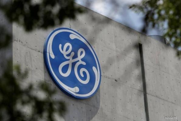 GE chief Culp says need to cut debt urgently, shares fall