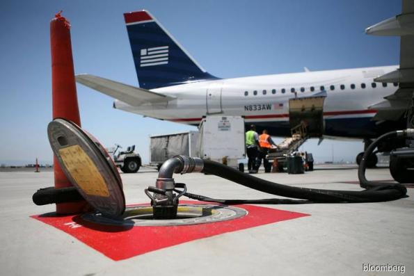 Global airline profit forecast cut by IATA on higher costs