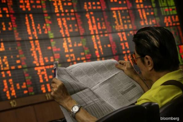 Global stocks fall, bonds rise as risk rally flags