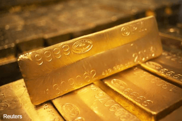 Gold drops on firmer US dollar as March rate hike bets rise
