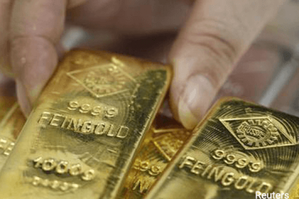 Gold slips on profit-taking, firm US dollar ahead of US jobs data