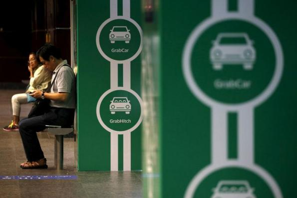 Grab launches grocery delivery service in race for growth