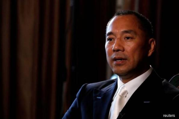 China hits fugitive tycoon's company with US$8.7b fine