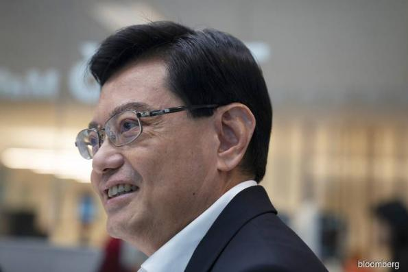 Singapore picks finance chief Heng to succeed Prime Minister Lee