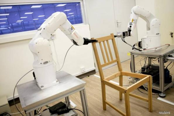 Flatpack fear no more? Robot assembles IKEA chair frame