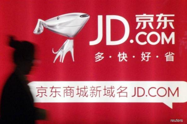 JD turns to Google, Walmart to build global e-commerce empire