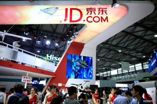 JD.com falls as report offers details of alleged Liu attack