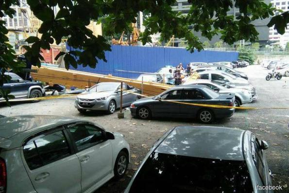 Collapsed crane damages vehicles opposite Dang Wangi police HQ