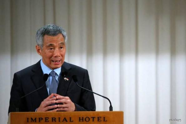 1MDB probe : Singapore says article on Lee Hsien Loong 'fake news, clearly libellous'