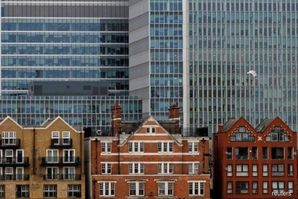 UK annual house price growth slows to 5-year low — Halifax