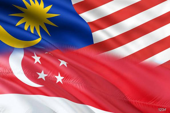 Malaysia, Singapore agree to steps to curb air, sea tensions