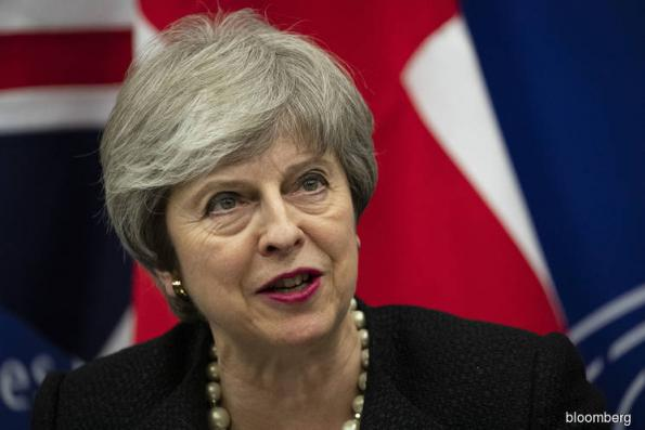 May strikes new Brexit deal and asks Parliament to back it