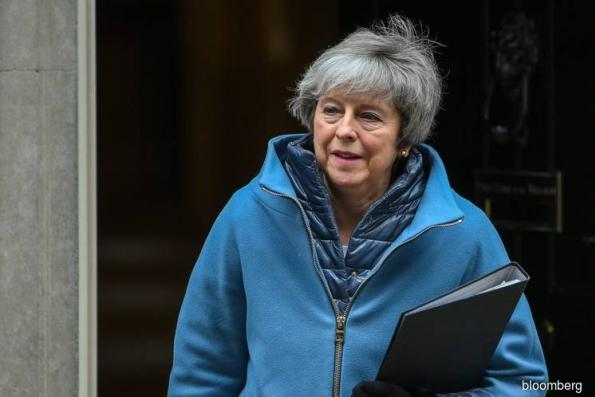 May Threatens a Long Brexit Delay, Her Top Aide Is Heard to Say