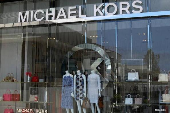 Michael Kors to take control of Italy's Versace — sources