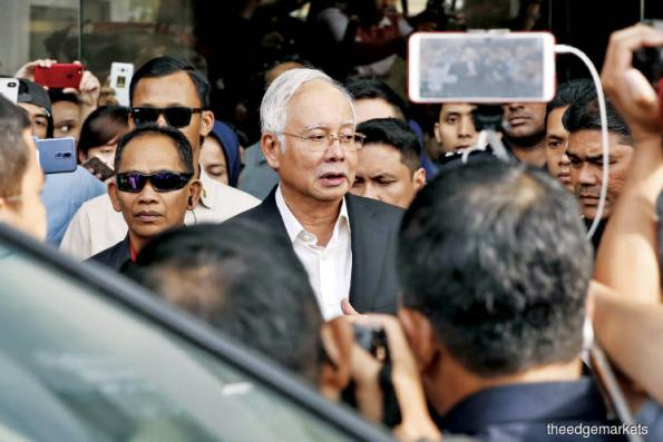 Najib to face 'several charges' over RM2.6b deposit in his account