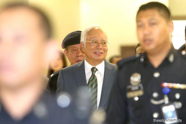 Decision tomorrow on Najib's trial date and gag order