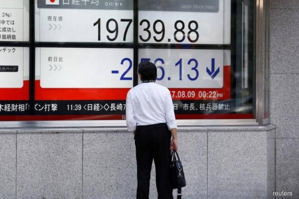 Nikkei falls as large caps sold; BOJ tankan outlook adds to concern