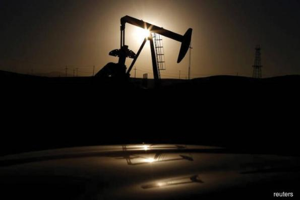 Oil gets a boost from Saudi output pledge, declining US inventories