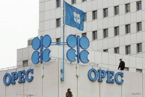 OPEC says oil glut almost gone, makes supply pledge amid Iran worries