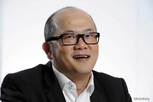 Singapore tycoon Ron Sim aborts HK IPO plan on market turmoil