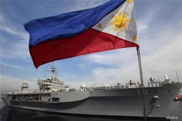 Philippines takes 'appropriate action' over Chinese bombers in disputed South China Sea