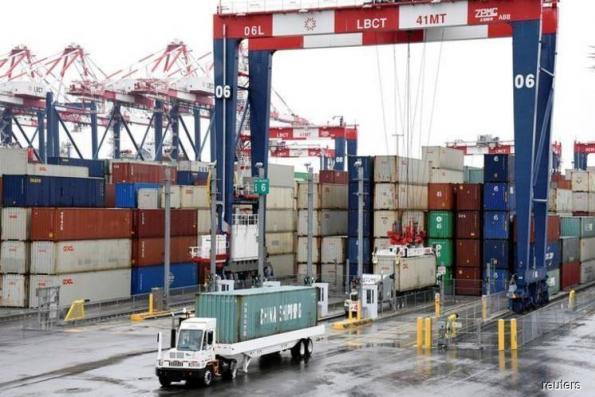 US business spending on equipment strong; trade deficit widens