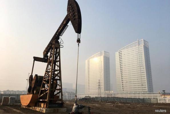 Oil dips as IMF lowers global growth outlook; eyes on U.S. hurricane