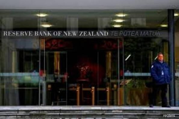 NZ central bank holds rates, signals accommodative policy through 2020