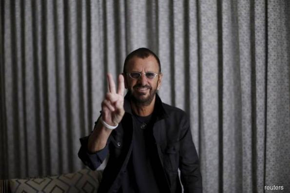 Arise Sir Ringo: Beatles drummer knighted at Buckingham Palace