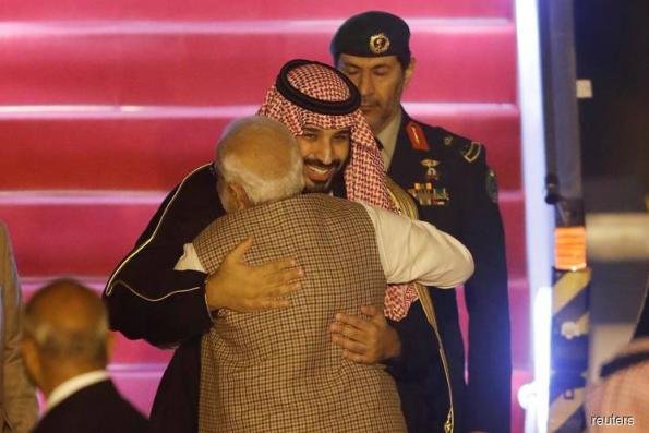 India's Modi breaks protocol to welcome Saudi's crown prince