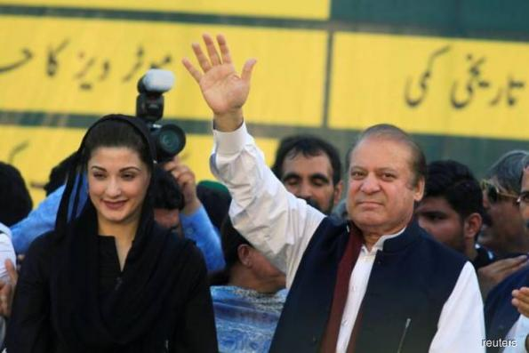 Wild celebrations as ousted Pakistan PM Sharif and daughter freed from jail