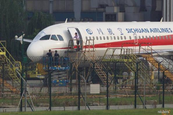 Sichuan Airlines co-pilot 'sucked halfway' out of cockpit, captain says