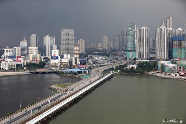 Singapore curbs may make property a buy, says CapitaLand CEO