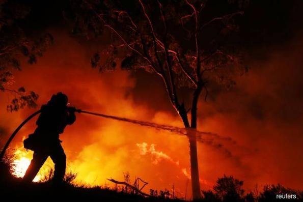 Firefighters battle intense wildfires ravaging southern California
