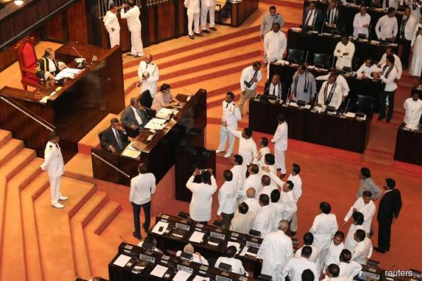 Bottles, chili paste thrown as Sri Lanka Parliament descends into farce