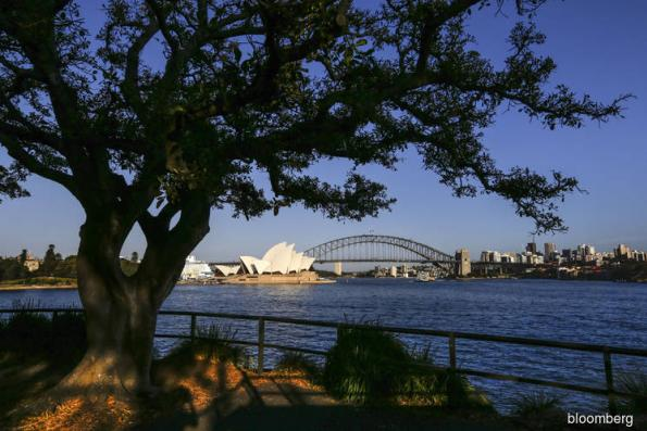 Australia's giants plan to get richer by shrinking fast