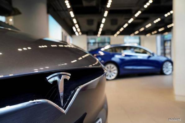 Tesla begins sales of cheaper Model 3 car variant in China
