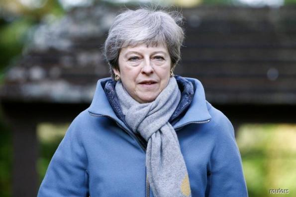 'Time's up, Theresa'? PM urged to set her own exit date to get Brexit deal